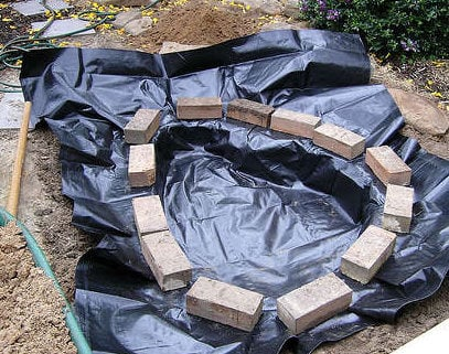 How to build a pond easily cheaply and beautifully the for Diy pond liner ideas