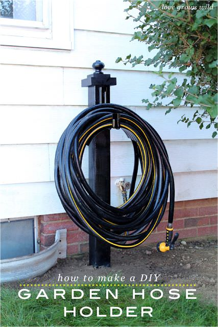 Garden Hose Storage Ideas great idea even swings around to point at you as you unwind it garden hose holderhose storagehose Diy Garden Hose Storage
