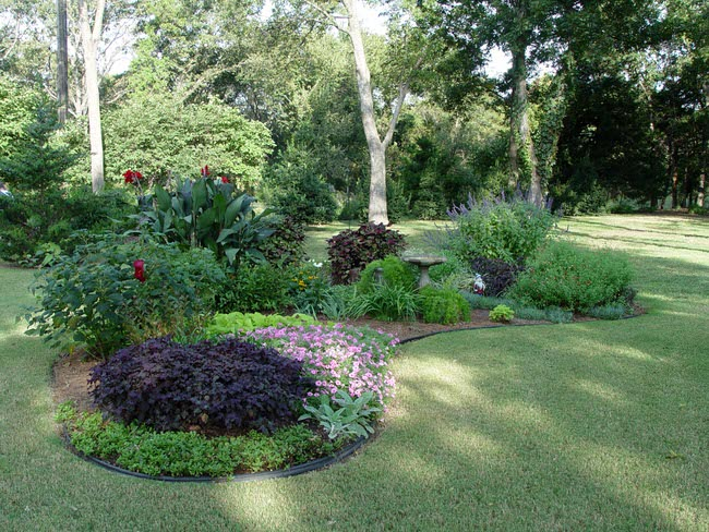 Design an island bed the garden glove for Island garden