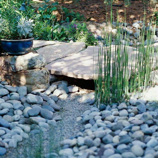 Diy dry creek beds the garden glove for How to build a river rock patio