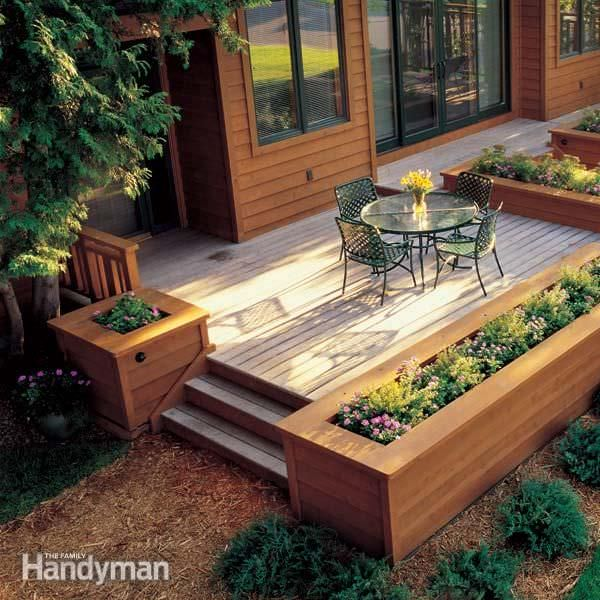 Built in planter ideas the garden glove for Deck garden box designs