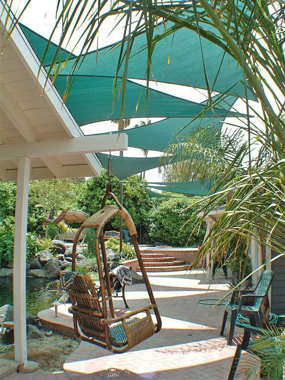9 Clever DIY Ways for a Shady Backyard Oasis | The Garden ... on Backyard Oasis Ideas id=20615