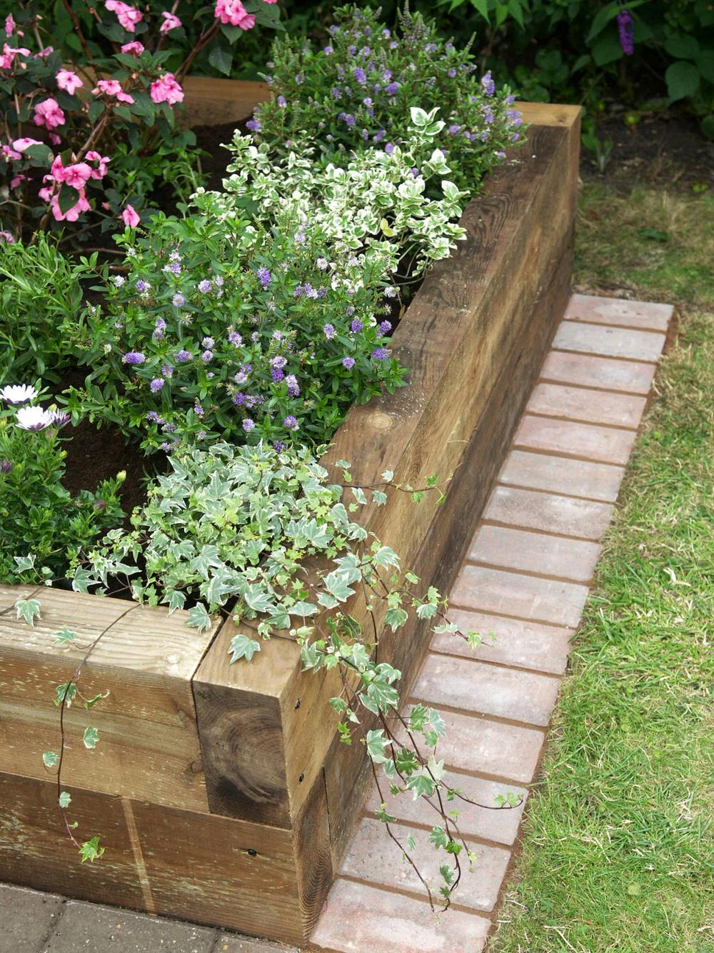 this is another version of a raised planter box using sleeper timbers this tutorial is mostly a photo tutorial but it does have a supply list and a - Garden Bed