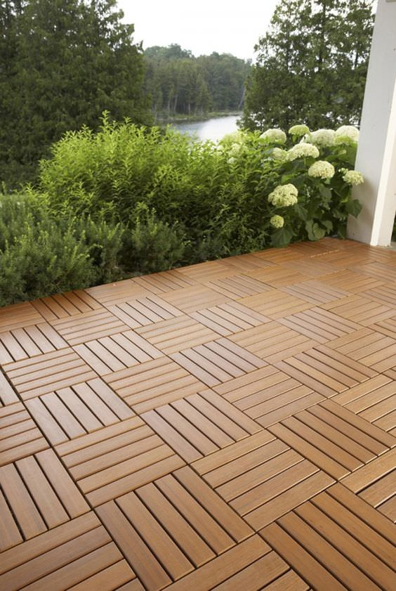 9 diy cool creative patio flooring ideas the garden glove for Garden decking squares